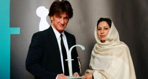 Actor and founder of J/P Haitian Relief Organisation Sean Penn presents the  2014 Front Line Defenders Award to Noozia Faridi of women's rights group SAWERA  in Dublin's City Hall. Photograph: Brenda Fitzsimons/The Irish Times