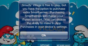 An iPhone display warning about in-app purchases on the game Smurfs' Village