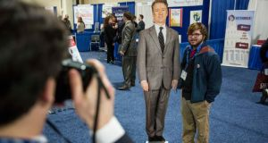 An attendee poses with a cutout of Republican Senator Rand Paul  at the annual Conservative Political Action Conference in Maryland. Photograph: Drew Angerer/The New York Times