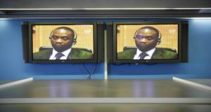 Germain Katanga appears on a monitor in the press room of the International Criminal Court in The Hague yesterday. Photograph: EPA/Phil Nijhuis