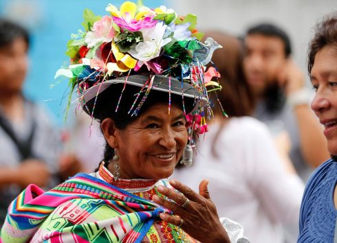 A Peruvian woman wearing traditional Andean clothes, participates in a march for International Women's Day in Lima. Photograph: Mariana Bazo/Reuters