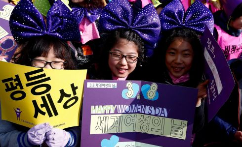 South Korean women cheer in celebration of International Women's Day in Seoul, South Korea. Photograph: Jeon Heon-Kyun