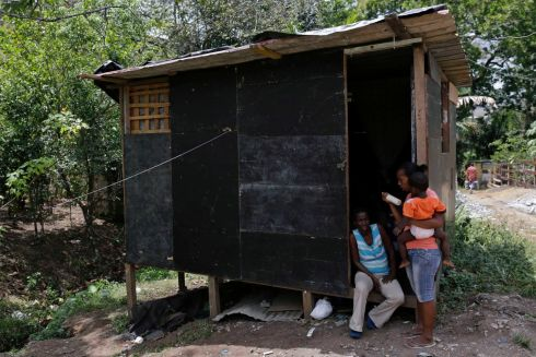 Maria Venite (r), aged 25, picks up her baby from her mother's house after work in Panama City. Photograph: Carlos Jasso/Reuters