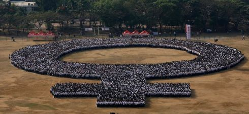 More than 10,000 participants joined a human formation at the Quirino Grandstand in Manila, the Philippines to set a new Guinness World Record as the 'Biggest human formation on women's symbol'.  Photograph: Ritchie B Tongo/EPA