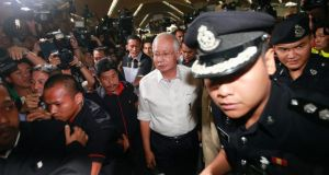 Malaysia's prime minister Najib Razak  arrives at the holding area for family and friends of passengers aboard missing Malaysia Airlines flight MH370, at Kuala Lumpur International Airport in Sepang today. Photograph: Samsul Said/Reuters
