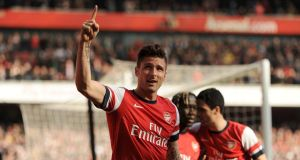 Arsenal's Olivier Giroud celebrates scoring his side's third goal. Photograph: Andrew Matthews/PA Wire.
