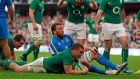 Jack McGrath celebrates Ireland's seventh and last  try against Italy. Photograph: Cathal McNaughton/Reuters