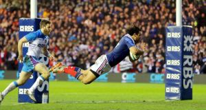 France's Yoann Huget goes over for his try in the Six Nations clash against Scotland at Murrayfield. Photograph: Morgan Treacy/Inpho