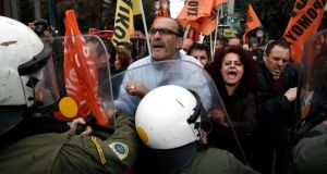 Protesters from the public sector scuffle with police during an anti-austerity rally outside the Finance Ministry in Athens February 28, 2014. REUTERS/Yorgos Karahalis (GREECE - Tags: POLITICS CIVIL UNREST BUSINESS)