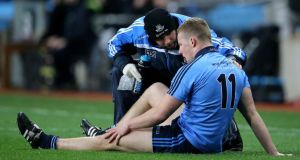 Dublin physio Kieran O'Reilly attends Ciarán Kilkenny after he suffered a cruciate knee injury in   the opening minutes of the Allianz League game against Kildare at Croke Park on Saturday night. Photograph:  Cathal Noonan/Inpho