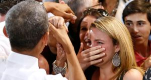 A woman cries while meeting US president Barack Obama at the Coral Reef High School in Miami, Florida, last week. Photograph: Reuters/Yuri Gripas