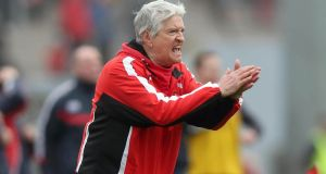 Derry manager Brian McIver urges on his side at Páirc Uí Rinn. Photograph: InphoDonall Farmer