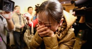 A relative of a passenger on board Malaysia Airlines flight MH370 cries at a Beijing hotel where families gathered yesterday. Photograph: Feng Li/Getty Images