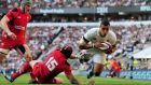 England rose blooming as dragon fire is doused