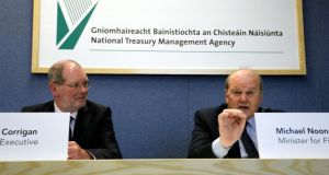 NTMA chief executive John Corrigan and Minister for Finance Michael Noonan at the launch of the NTMA's Annual Report 2012. Photograph: Brenda Fitzsimons.