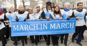 "From left: Cindy McCain, Trudy Styler, Ban Soon-Taek, Kim Cattrall, Naomi Campbell, Muna Rihani Al Nasser and Nassir Al-Nasser attend the ""March in March"" to end violence against women, at The United Nations last week on International Women's Day. Photograph: Jamie McCarthy/Getty Images"
