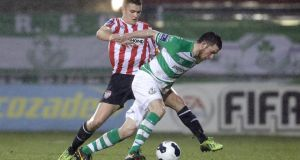 Ryan Brennan attempts to keep Derry's Michael Duffy at bay.  Photograph: Inpho/Morgan Treacy