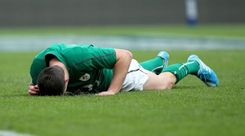 Sexton down injured after taking a knock following his try. Photograph: Dan Sheridan/Inpho
