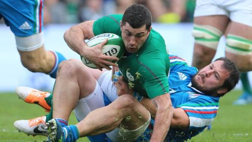 Rob Kearney tries to get past Alberto de Marchi. Photograph: Niall Carson/PA Wire.