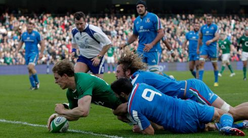 Andrew Trimble scores his Ireland's second try despite the the attentions of Tito Tebaldi and Joshua Furno. Photograph: Brian Lawless/PA Wire.