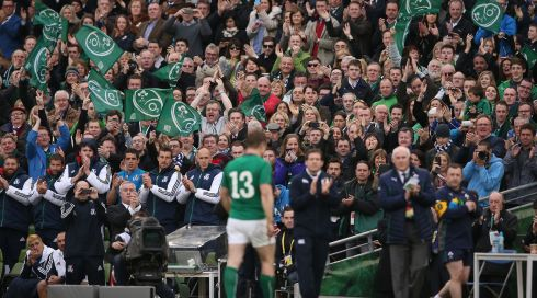 Brian O'Driscoll receives a standing ovation as he leaves the pitch at the Aviva Stadium for the last time as an Ireland player. Photograph:<EN>Billy Stickland/Inpho