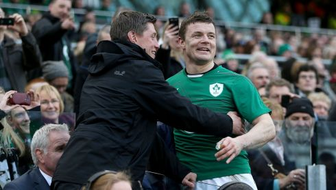 Brian O'Driscoll is congratulated by Ronan O'Gara after he is substituted. Photograph: Dan Sheridan/Inpho