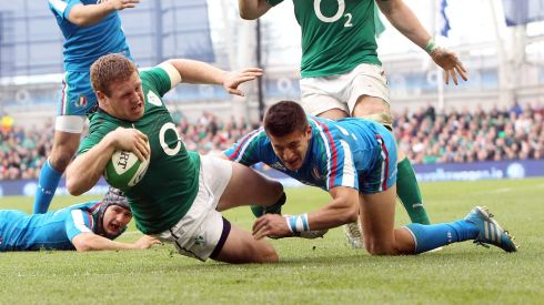 Ireland's Sean Cronin goes over for a try despite the efforts of Tommaso Allan. Photograph: Colm O'Neill/Inpho