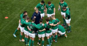 Joe Schmidt gives the Ireland backs some final instructions ahead of the Italy game. Photograph: Ryan Byrne/Inpho