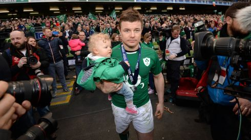 Showing daughter Sadie an arena full of noise. Probably a small bit overwhelming! Photograph: Dara Mac Dónaill/The Irish Times