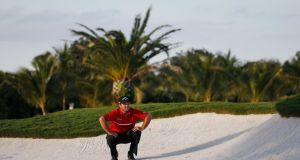 Patrick Reed waits in a bunker to play a shot on the 17th hole at Trump National Doral. Photograph: Chris Trotman/Getty Images