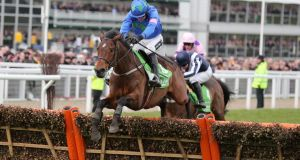 Hurricane Fly, ridden by Ruby Walsh, regains his Stan James Champion Hurdle crown at last year's Cheltenham Festival.