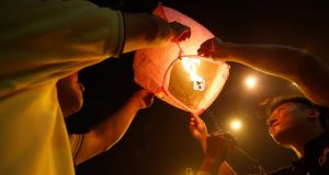 Malaysian ethnic Chinese launch a lantern at a vigil for the passengers of Malaysia Airlines MH370, held near Independence Square in Kuala Lumpur yesterday. Photograph: Edgar Su/Reuters