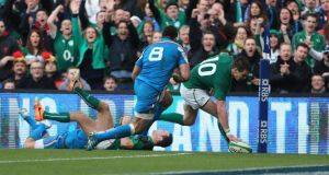Johnny Sexton scores his second try against Italy last weekend. Photograph: Niall Carson/PA Wire.