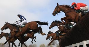 Teaforthree (left) ridden by JT McNamara on his way to winning the Diamond Jubilee National Hunt steeple chase race at Cheltenham on March 14th, 2012. Photograph: Michael Steele/Getty Images