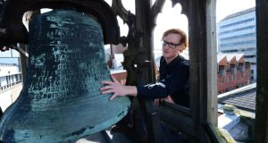 Conor Byrne, events manager at Smock Alley Theatre, with the 300-year-old bell.  Photograph: Bryan O'Brien