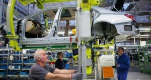Workers at a car factory in Germany. New figures show imports increased by 4.1 per cent in January while exports were up 2.2 per cent
