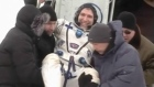 An American astronaut and two Russians who carried a Sochi Olympic torch into open space landed safely and on time on Tuesday (March 11) in Kazakhstan, defying bad weather and ending their 166-day mission aboard the International Space Station.
