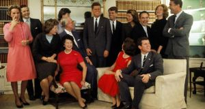 Portrait of members of the Kennedy family, including Rose Kennedy (seated fourth from left), at their home in Hyannis Port, Massachusetts on the night after John F Kennedy won the 1960 US Presidential election,  November 9th, 1960. Photo: Getty Images