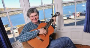 Singer-songwriter John Spillane in his bedroom looking out on the River Lee, Passage West, Cork. Photograph: Daragh Mc Sweeney/Provision