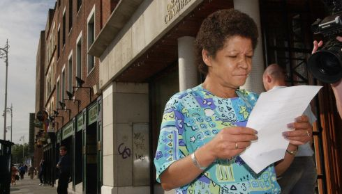 Christine Buckley peruses a statement resulting from a meeting  with survivor support groups and the Department of Education & Science outside the National Office for Victims of Abuse in Dublin in September 2003. Photograph: Dara Mac Dónaill/The Irish Times