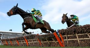 Jezki ridden by Barry Geraghty clears the last ahead of My Tent Or Yours on the way to winning the Champion Hurdle at Cheltenham. Photograph: Dan Sheridan/Inpho
