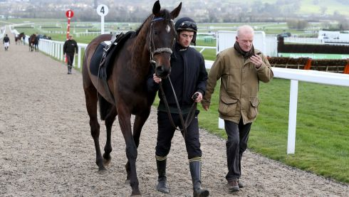 Trainer Willie Mullins was busy and joined his son Patrick  and Black Hercules out on the course. Photograph: Inpho/Dan Sheridan