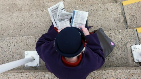 A punter checks the form before the first race. Photograph: David Davies/PA Wire