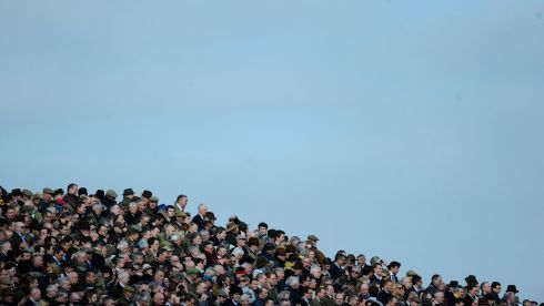 Racegoers wait for the start of the second race. Photograph: Alan Crowhurst/Getty Images
