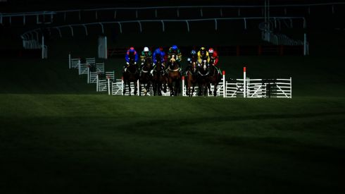 The riders in the Champion Hurdle race through a patch of sunlight.  Photograph: Richard Heathcote/Getty Images