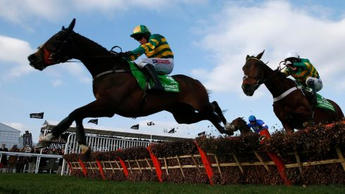 Jockey Barry Geraghty riding Jezki (L) clears the final fence ahead of jockey Tony McCoy (R) on My Tent Or Yours on the way to winning the Champion Hurdle Challenge Trophy. Photograph: Eddie Keogh/Reuters