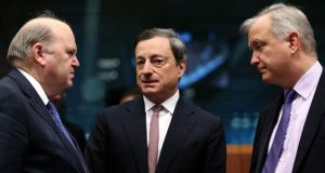 European Central Bank president Mario Draghi  (centre) with Minister for Finance Michael Noonan and European Economic and Monetary Affairs Commissioner Olli Rehn attend an euro zone finance ministers' meeting in Brussels on Monday. Photograph: Reuters/Francois Lenoir