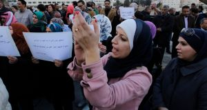 Jordanian protesters shout slogans against Israel during a protest in front of the parliament in Amman. Photograph: Muhammad Hamed/Reuters