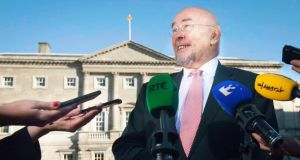 Minister for Education and Skills Ruairí Quinn speaking to media outside Leinster House yesterday in relation to protests by teachers over the new junior cycle. Photograph: Gareth Chaney/Collins