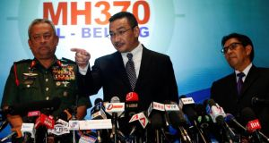Malaysia's acting transport minister Hishammuddin  Hussein answers questions at a media briefing today, in  between Chief of the Armed Forces Gen Zulkifeli Mohd Zin (left) and the Malaysian Department of Civil Aviation's director general Azharuddin Abdul Rahmanthe on the missing Malaysia Airlines MH370 jet. Photograph: Edgar Su/Reuters